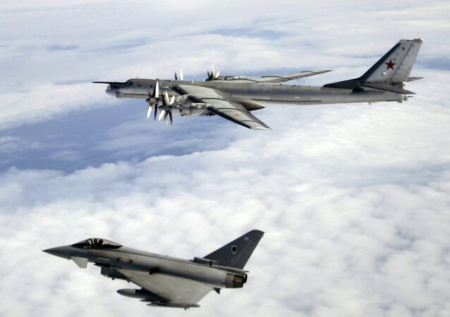 A Tu-95 being escorted by an RAF Typhoon. File photo