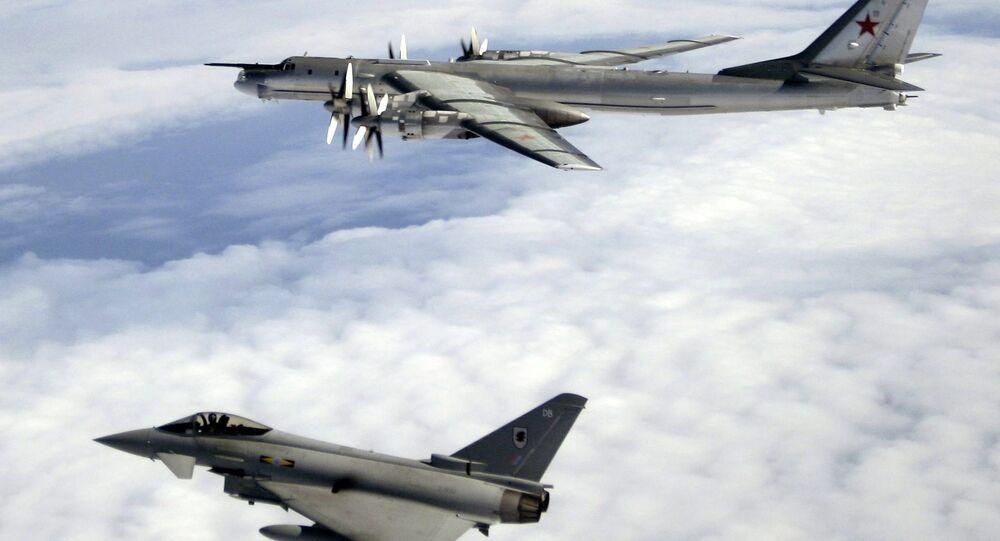 A Tu-95 escorted by an RAF Typhoon