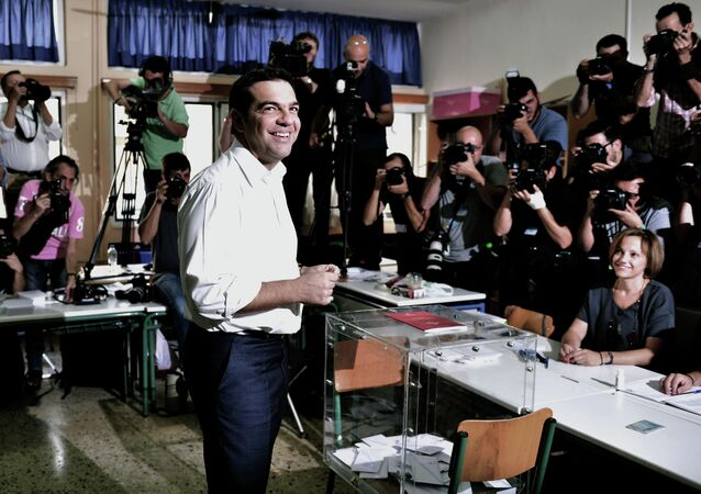 Greek radical-left Syriza party leader and former Prime Minister Alexis Tsipras smiles prior to cast his vote at a polling station in central Athens on September 20, 2015