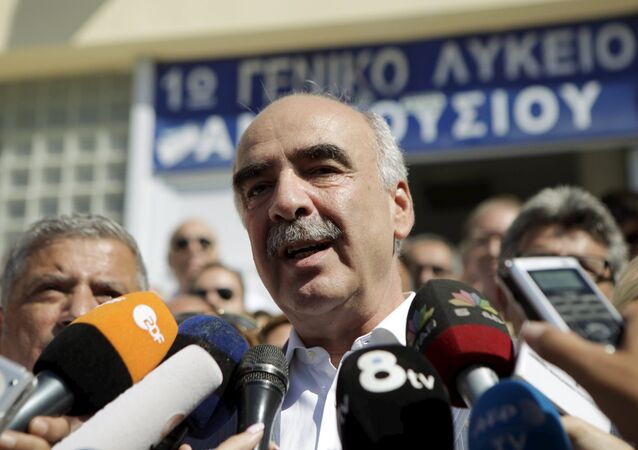 Conservative New Democracy leader Vangelis Meimarakis talk to the media after voting for the general election in Athens, Greece, September 20, 2015