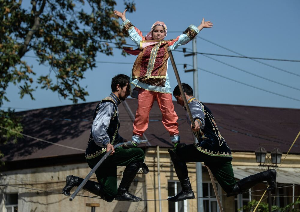 Festival participants offering viewers daring highwire performance on Freedom Square, central Derbent.