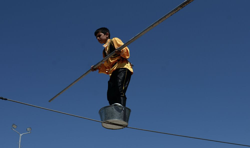 A boy performing a daring highwire act on Freedom Square.