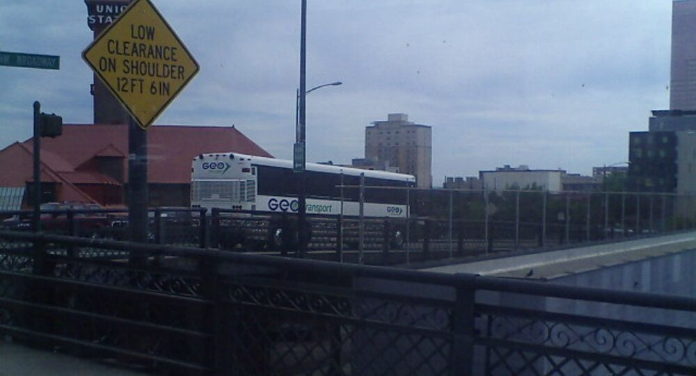 A GEO Transport bus arrives from the Northwest Detention Center