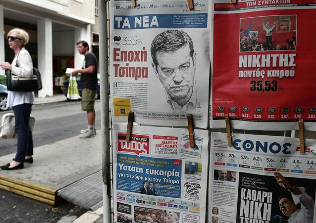 Frontpages of newspapers bear pictures of Syriza leader Alexis Tsipras a day after the Greek general election in Athens on September 21, 2015