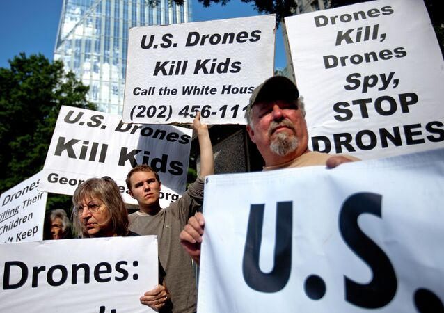 File photo of demonstrators protest against the use of drones outside the International Conference on Unmanned Aircraft Systems at the Grand Hyatt Hotel, Tuesday, May 28, 2013, in Atlanta