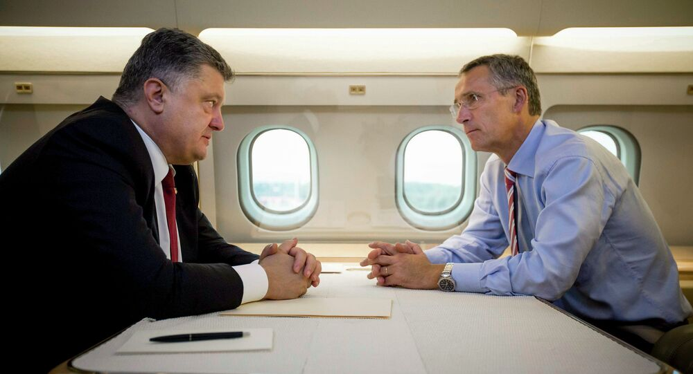 Ukrainian President Petro Poroshenko, left, and NATO Secretary General Jens Stoltenberg talk in a helicopter on the way to a military training ground outside Lviv, western Ukraine, Monday, Sept. 21, 2015