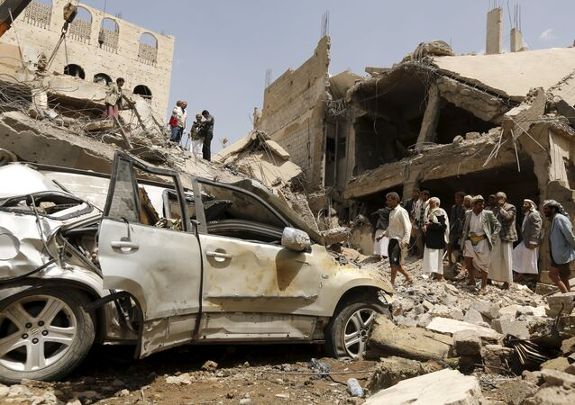People gather at the site of a Saudi-led air strike in Yemen's capital Sanaa September 21, 2015