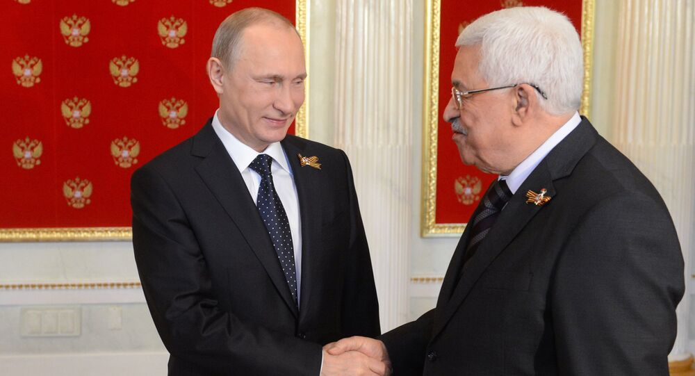 May 9, 2015. Russian President Vladimir Putin (left) welcomes President of Palestine Mahmoud Abbas during his meeting with foreign delegation heads and honorary guests in the Kremlin