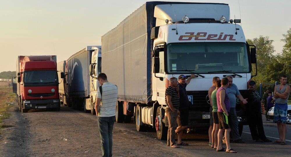 Truck drivers gather next to their trucks, near to border crossing point at Kalanchak, on September 20, 2015