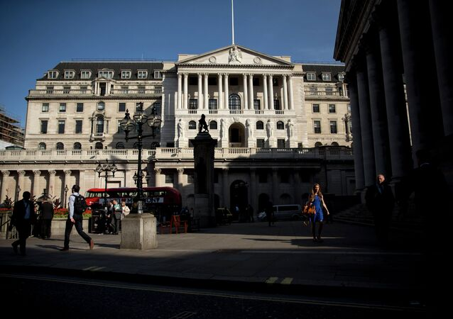 People walk past the Bank of England in the City of London, Tuesday, Aug. 25, 2015