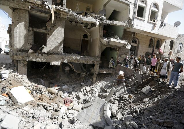 People gather at the site of a Saudi-led air strike in Yemen's capital Sanaa September 22, 2015