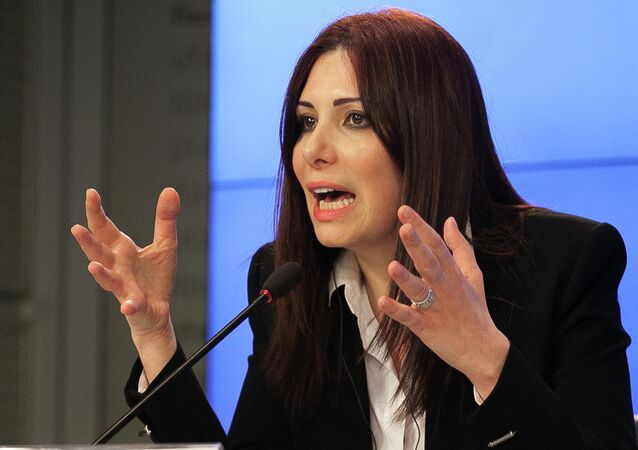 Member of the opposition delegation Randa Kassis speaks at a press conference in Moscow on April 9, 2015 after talks between the Syrian government and members of the domestic opposition