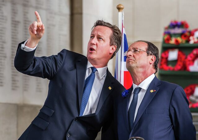 British Prime Minister David Cameron (left) speaks with French President Francois Hollande (right)