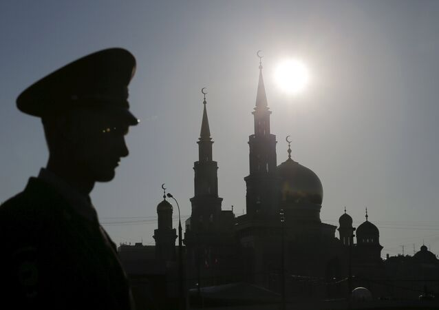 An Interior Ministry member stands guard near the Moscow Grand Mosque before an opening ceremony in Moscow, Russia, September 23, 2015