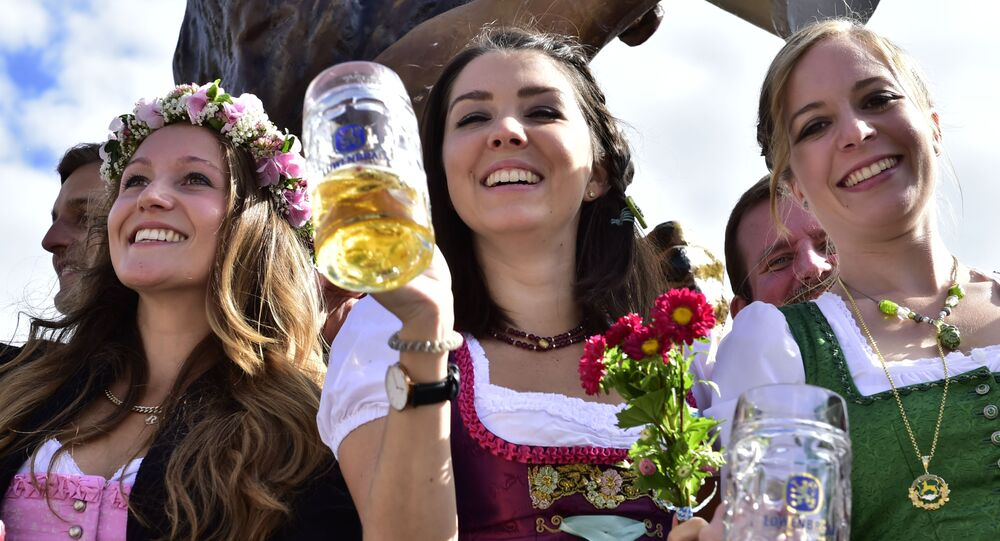 Young women celebrate the opening of the 182. Oktoberfest beer festival in Munich, southern Germany, Saturday, Sept. 19, 2015