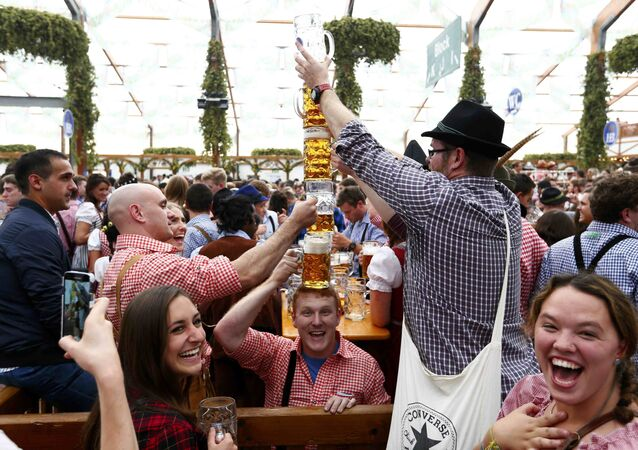 Visitors joke with beer mugs on the first day of the 182nd Oktoberfest in Munich, Germany, September 19, 2015