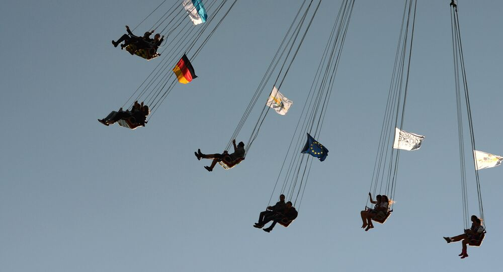 A picture taken on September 21, 2015 shows people enjoying a ride of a carousel at the Theresienwiese grounds of the Oktoberfest beer festival in Munich