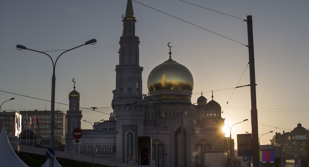 The recently restored Moscow Cathedral Mosque is silhouetted against the sky brightened by the rising sun in Moscow, Russia, Wednesday, Sept. 23, 2015