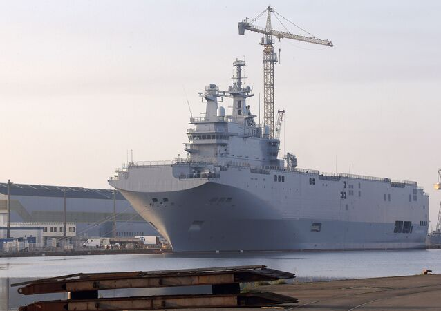 In this Friday, Sept. 5, 2014 file photo, the Vladivostok warship, the first of two Mistral-class helicopter carriers ordered by Russia, docks on the port of Saint-Nazaire, western France.