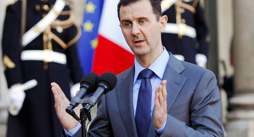 In this Thursday Dec. 9, 2010 file photo, Syria President Bashar al-Assad addresses reporters following his meeting with French President Nicolas Sarkozy at the Elysee Palace in Paris, France.