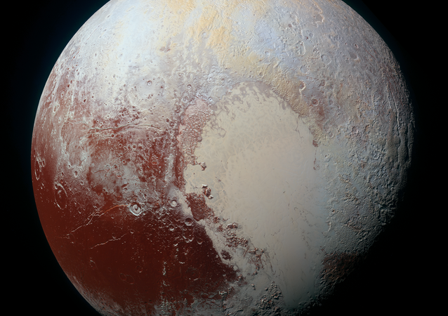 This image combines blue, red and infrared images taken by the Ralph/Multispectral Visual Imaging Camera (MVIC). Pluto's surface sports a remarkable range of subtle colors, enhanced in this view to a rainbow of pale blues, yellows, oranges, and deep reds.