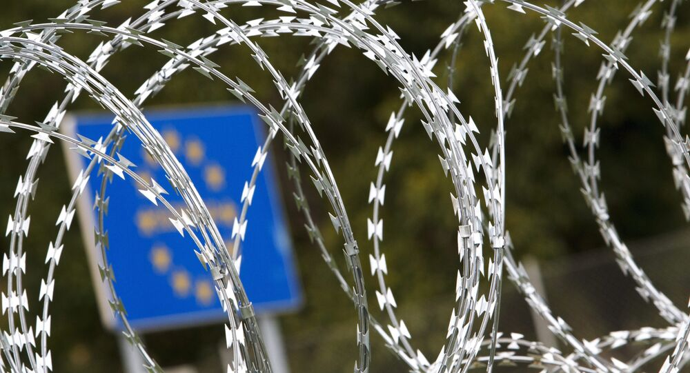 A razor wire fence installed by Hungarian soldiers is seen at the border between Hungary and Slovenia near Tornyiszentmiklos, 245 kms southwest of Budapest, Hungary, Thursday, Sept. 24, 2015