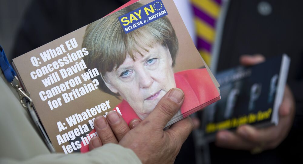 A supporter holds leaflets showing German Chancellor Angela Merkel, as they distribute them in Ramsgate, east of London, as Leader of the UK Independence Party (UKIP) Nigel Farage (not pictured) kicks off their Say No To The EU tour on September 7, 2015, during the party's referendum campaign.