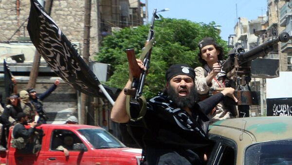 Fighters from Al-Qaeda's Syrian affiliate Al-Nusra Front drive in the northern Syrian city of Aleppo. - Sputnik International