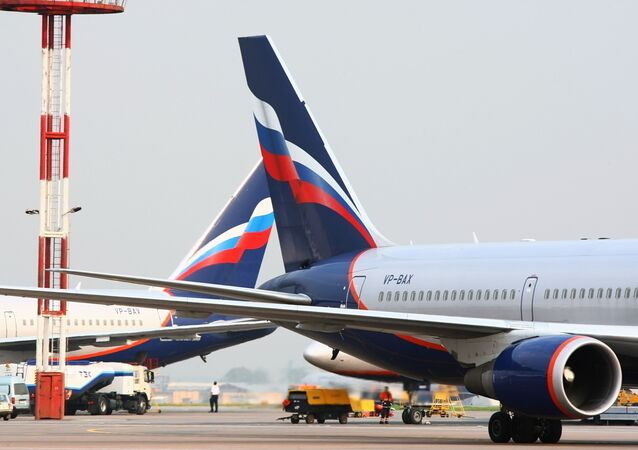 An Aeroflot Boeing 767, right, at the Sheremetyevo International Airport in Moscow