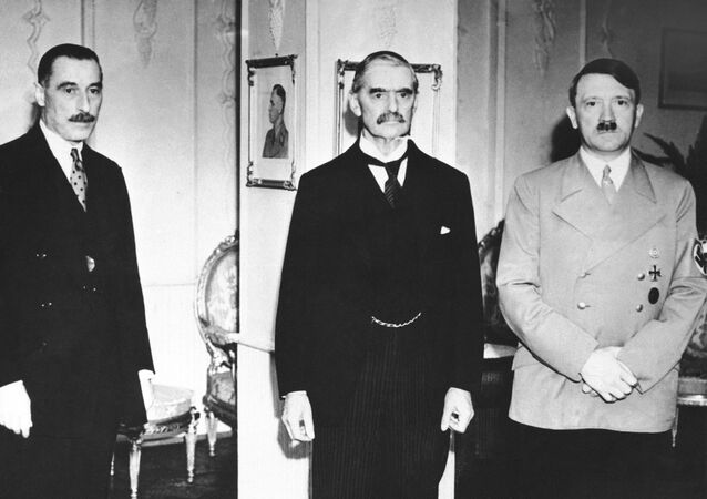 Neville Chamberlain, British prime minister, center, with Reichsfuehrer Adolf Hitler, right, at the second of their three dramatic meetings to solve the European crisis at the conclusion of the three-hour midnight conference which ended in disagreement in Hitlerís hotel room in Godesberg, Germany around Sept. 23, 1938