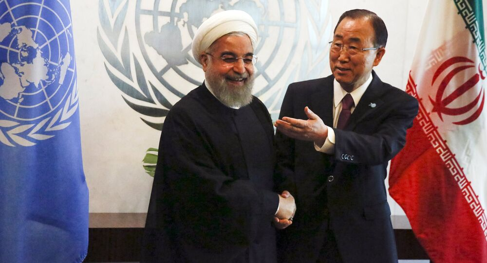 UN Secretary-General Ban Ki-moon (R) gestures as he poses for a photograph with Iran's President Hassan Rouhani during their meeting ahead of the United Nations General Assembly at the United Nations Headquarters in New York, September 26, 2015.
