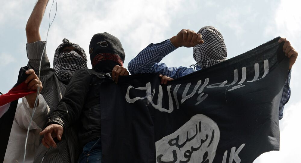 Kashmiri demonstrators hold up a flag of the Islamic State of Iraq and the Levant (ISIL) during a demonstration against Israeli military operations in Gaza, in downtown Srinagar on July 18, 2014