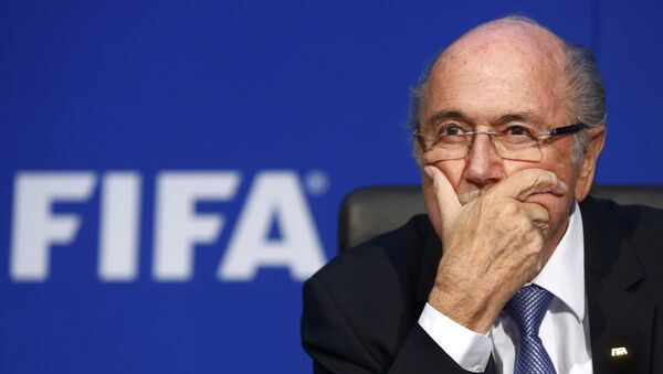 FIFA President Sepp Blatter reacts during a news conference after the Extraordinary FIFA Executive Committee Meeting at the FIFA headquarters in Zurich, Switzerland, in this July 20, 2015 file photo - Sputnik International