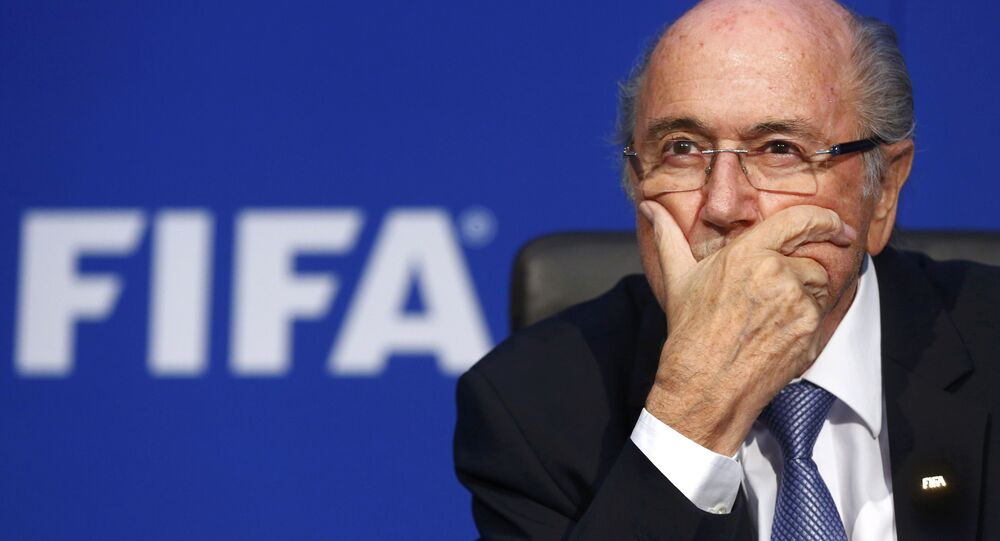 FIFA President Sepp Blatter reacts during a news conference after the Extraordinary FIFA Executive Committee Meeting at the FIFA headquarters in Zurich, Switzerland, in this 20 July 2015 file photo