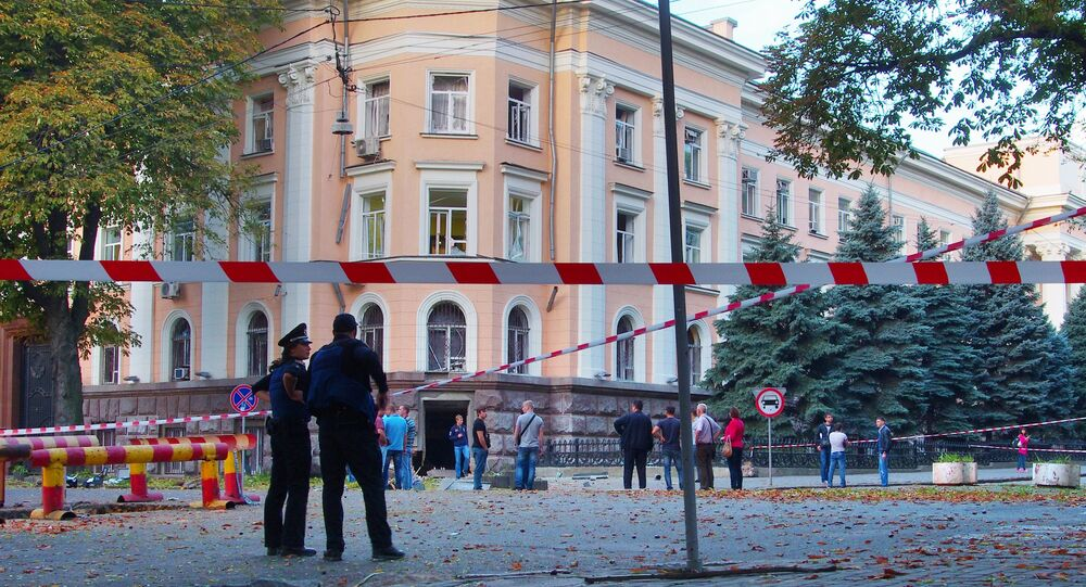 Police experts examine the site of a blast outside the security service (SBU) regional building in central Odessa on September 27, 2015