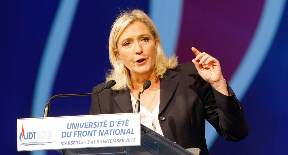 President of France's far right National Front party Marine Le Pen, delivers her speech during their summer meeting, in Marseille, southern France, Saturday, Sep. 6, 2015