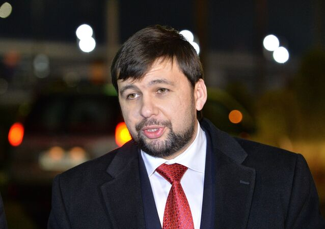 Representative of the Donetsk People's Republic (DPR) Denis Pushilin talks with journalists at the Minsk airport