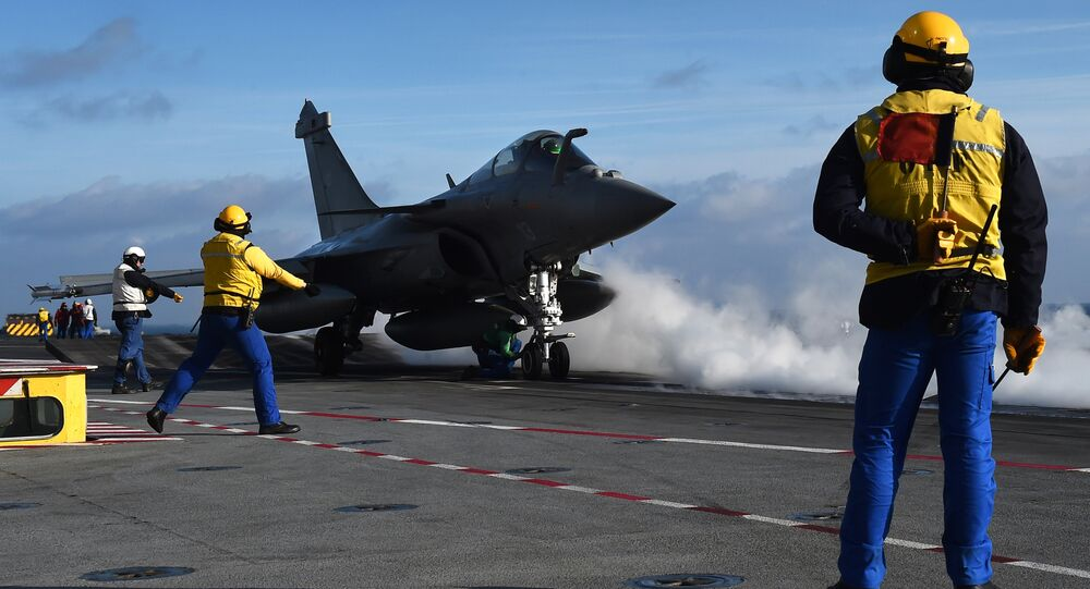 French Rafale fighter aircraft is about to take off on the flight deck, on the French aircraft carrier Charles-de-Gaulle at sea off the coast of Toulon, southern France, on January 15, 2015