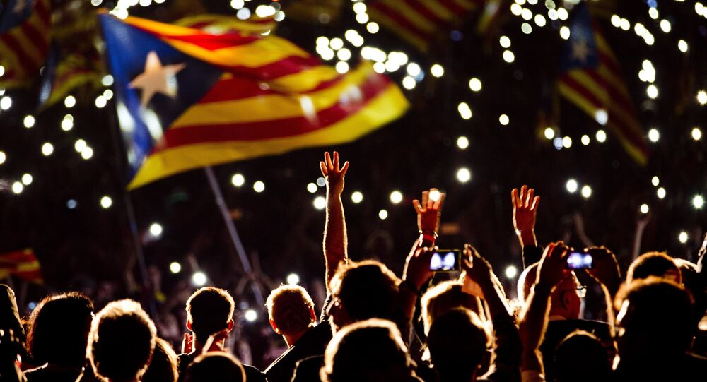 Pro independence supporters wave estelada or pro independence flags during a rally of Junts pel Si or Together for YES in Barcelona, Spain, Friday, Sept. 25, 2015