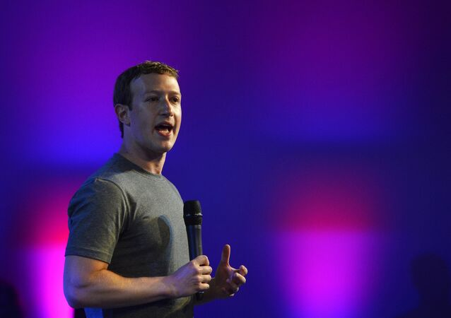 US chairman and chief executive of Facebook Mark Zuckerberg gestures as he announces the Internet.org Innovation Challenge in India in New Delhi on October 9, 2014.