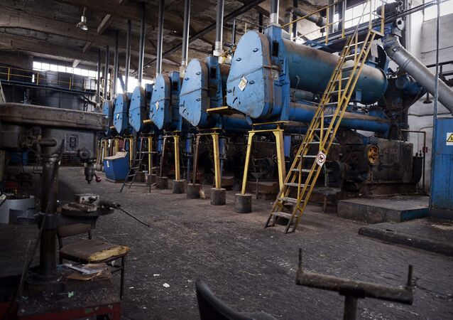 Heavy machinery gathers dust at a closed oil production factory at Livadia industrial area in Boeotia region in central Greece on this picture taken on December 28, 2013