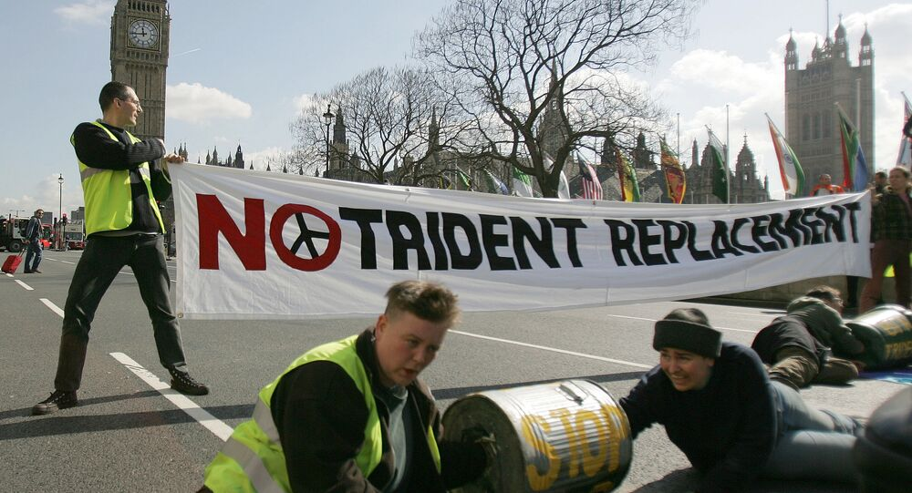 Anti-nuclear protesters block a road in Parliament Square in London, ahead of a House of Commons vote on the upgrade of Britain's current nuclear weapons the Trident missile, Wednesday March 14, 2007.