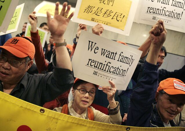A group of Asian-Americans joins others that support reform of immigration legislation at a rally in New York, Tuesday, May 1, 2007