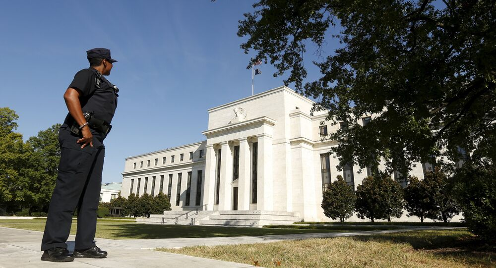 A Federal Reserve police officer keeps watch while posted outside the Federal Reserve headquarters in Washington September 16, 2015