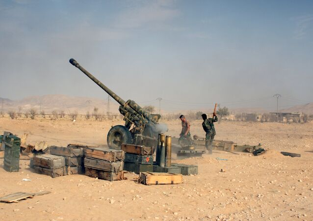 Syrian troops shoot at the positions of Islamists near Tadmor (Palmyra) in Syria