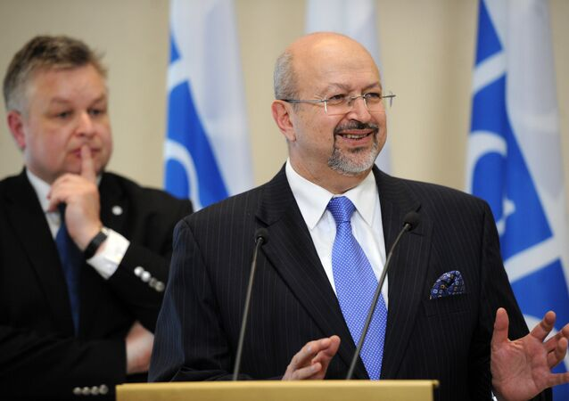 Lamberto Zannier (R), Secretary General of the Organization for Security and Cooperation in Europe (OSCE)