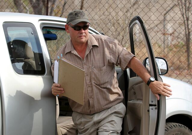 Zimbabwean hunter Theo Bronkhorst arrives at court in Hwange September 28, 2015