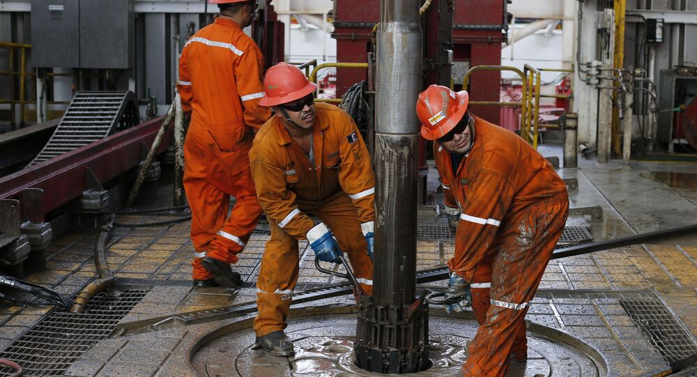 FILE - In this Nov. 22, 2013 file photo, oil workers set the drill on the Centenario deep-water drilling platform off the coast of Veracruz, Mexico in the Gulf of Mexico