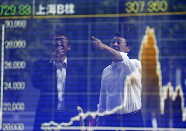 Tokyo businessmen react as they are reflected on a graph showing recent movements of Shanghai Stock Exchange B share index outside a brokerage in Tokyo, Japan, September 29, 2015
