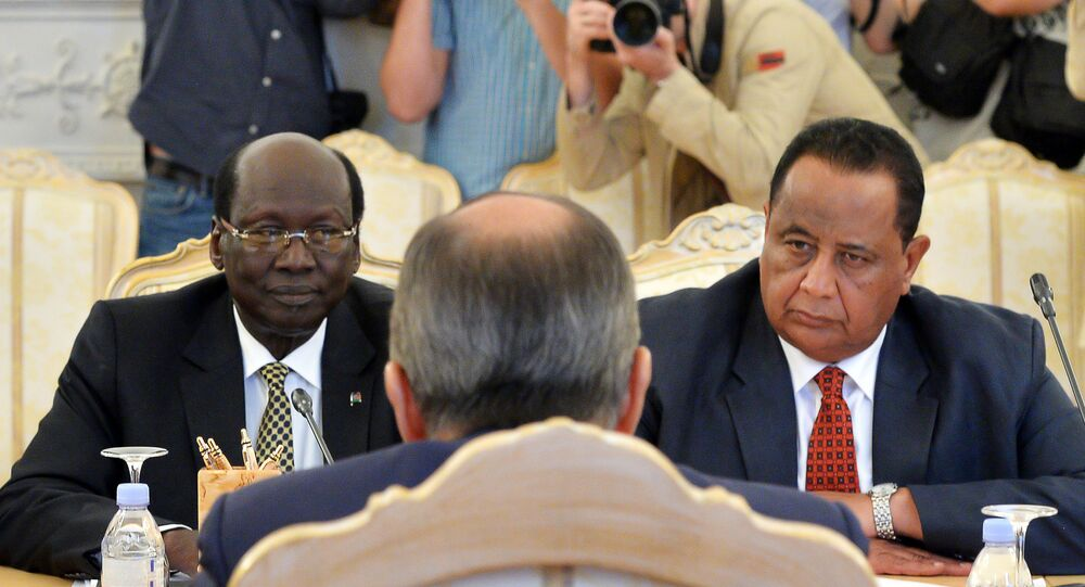 Foreign Minister of the Republic of South Sudan Barnaba Benjamin (left) and Foreign Minister of Sudan Ibrahim Ghandour during a meeting with Russian Foreign Minister Sergey Lavrov in Moscow